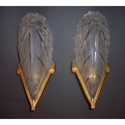 Pair of antique French Art Deco wall lights with gilt bronze mounts. Circa 1930