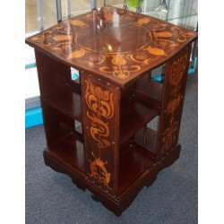 Probably by Liberty & Co mahogany with fruitwood inlay revolving bookcase. Circa 1900