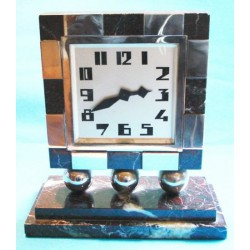 Art Deco chrome and marble clock with eight day movement. French. Circa 1925