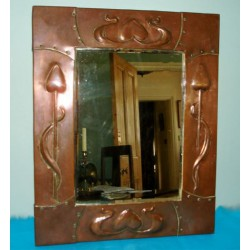 Arts & Crafts/Art Nouveau wall mirror copper with original plate. Circa 1900
