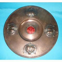 Arts & Crafts wall charger, copper insert with red enamel. Circa 1900