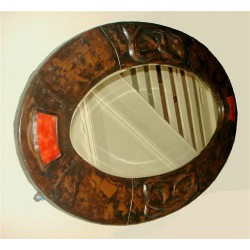 Arts & Crafts beaten copper wall mirror with entrelac decoration and inset red enamel plaques (c.1900)