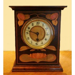 Art Nouveau mahogany and fruit woods mantle clock with eight day movement (c.1900)
