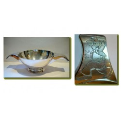 R.E. Stone Arts & Crafts silver quaich with handles engraved with clowns. Hallmarked R.E.S. London 1938