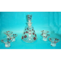 Bohemian glass decanter and six glasses. Decorated with red enamel (c.1930)
