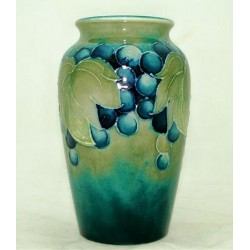 William Moorcroft leaves and berries vase in rare Celadon colourway. Impressed Made in England to base and signed. (c.1930)