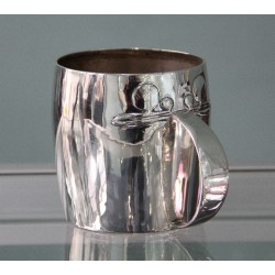 """Antique Archibald Knox for Liberty & Co Cymric silver tankard with turquoise cabochon and inscribed """"Your very good health""""."""