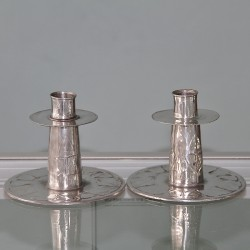 Pair of Archibald Knox for Liberty & Co pewter candlesticks. Stamped 0219. Circa 1903