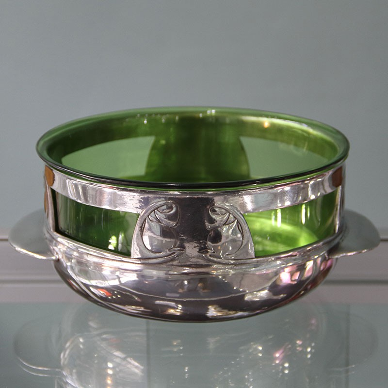 Pewter bowl by Archibald Knox for Liberty & Co with original green Powell glass liner (c.1903)
