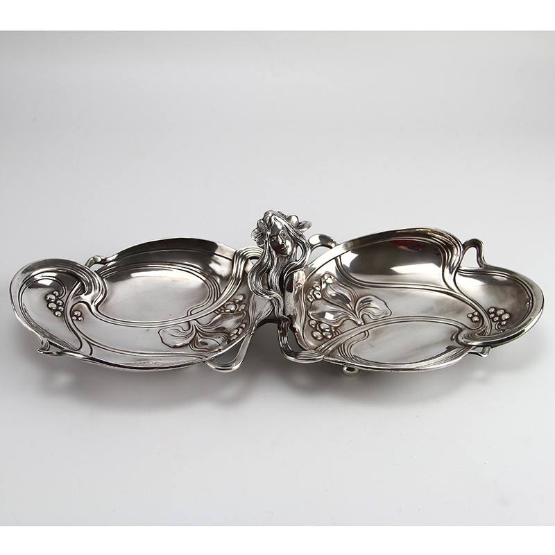 Art Nouveau silver plated sweet dish with flowing maiden head handle. Circa 1900.
