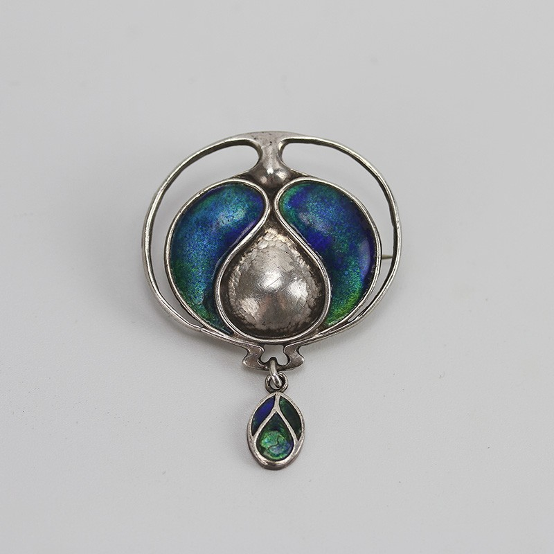 Murrle Bennett & Co Art Nouveau silver brooch with enamel in shades of peacock blue and green. (c.1900)