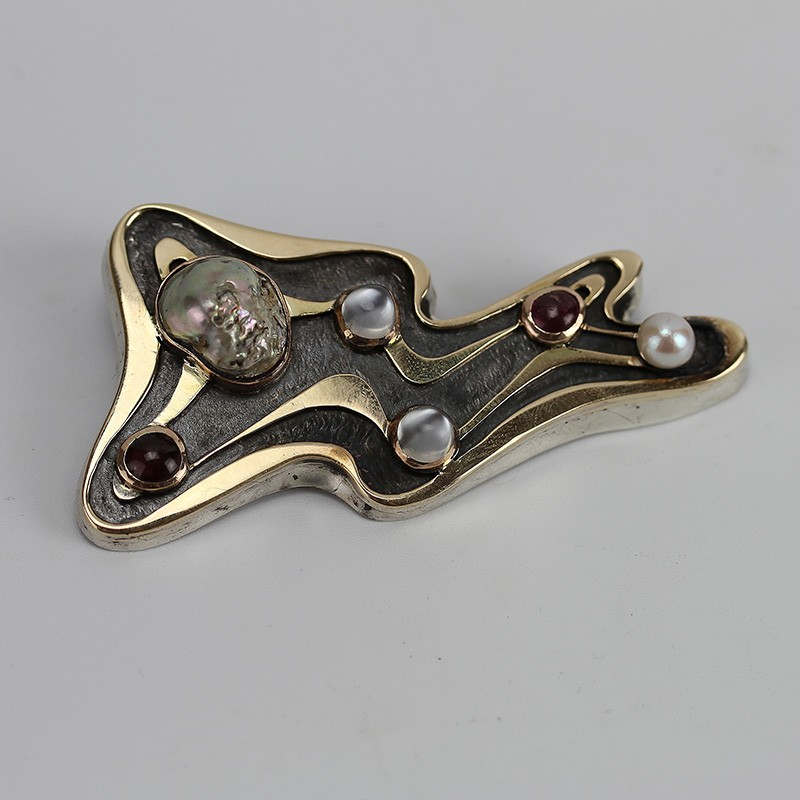 Mid century Silver Modernist brooch overlaid with 14ct gold and inset with Ruby, Pearl and Moonstone cabochons.
