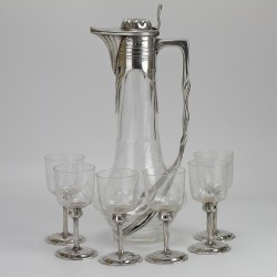 Orovit Art Nouveau pewter claret jug and six glasses. All with original crystal cut glass liners. (c.1900)