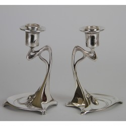 Pair of WMF Art Nouveau silver plated candlesticks of sinuous form with acorn decoration. (c.1900)