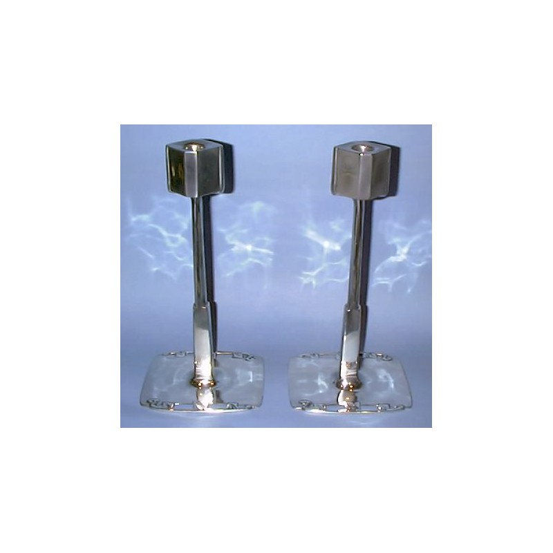Archibald Knox for Liberty & Co pair of important candlesticks, pewter. Stamped marks: English pewter No.0725. (c.1903)