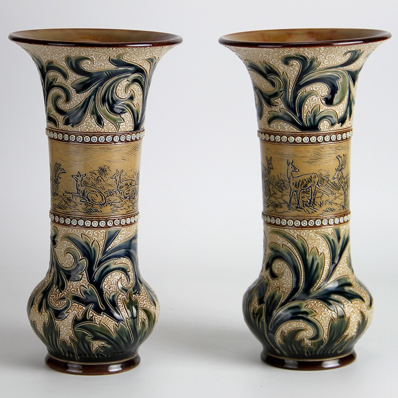 Doulton Lambeth pair of stoneware vases with decoration by Hannah Barlow depicting deer and stags. (c.1890)