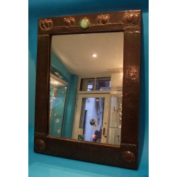 Possibly Archibald Knox design copper wall mirror with original glass plate (c.1903)