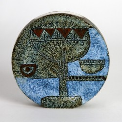 Troika Wheel vase decorated in shades of blue and green with incised decoration.