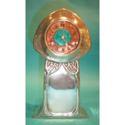 Archibald Knox for Liberty & Co pewter clock. Stamped marks 0371 Tudric. (c.1903)
