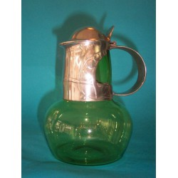 Archibald Knox for Liberty & Co decanter. Pewter with Powell glass liner. Marked number 0310 (c.1905)
