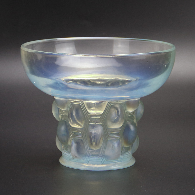Lalique opalescent blue vase in the Beautrellis pattern. The lower half decorated with near oval cabochons