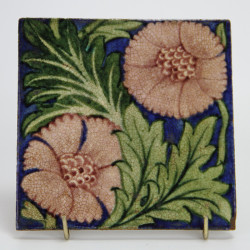 Antique Willian De Morgan Tile with two pink flower heads and green foliage on a blue ground (c.1890)