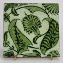 Antique William De Morgan tile with Green foliage in a Persian inspired design. (c.1890)