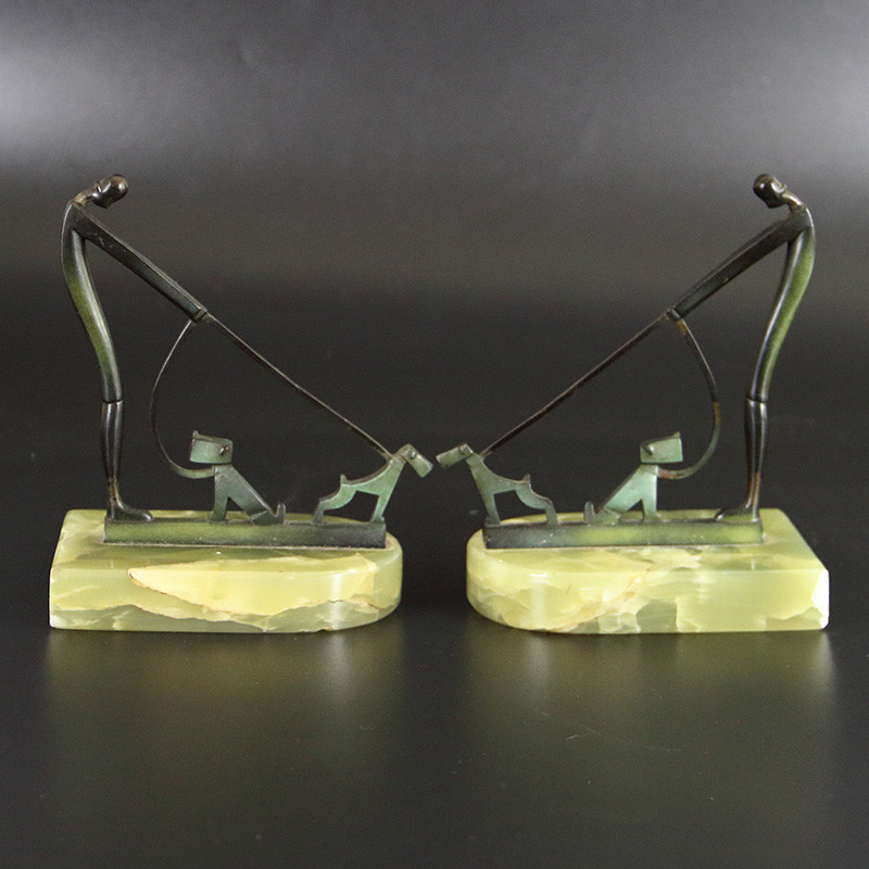 In the Manner of Hagenauer - Pair of Bronze Bookends with Figures and Dogs on a Leash (c.1930)