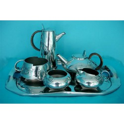 Archibald Knox for Liberty & Co pewter tea set. Comprising tray, teapot, sugar bowl, milk jug, coffee pot and slop bowl.