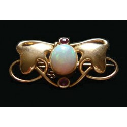 Murrle Bennett 15ct Gold opal and ruby brooch. Stamped marks (c.1900)