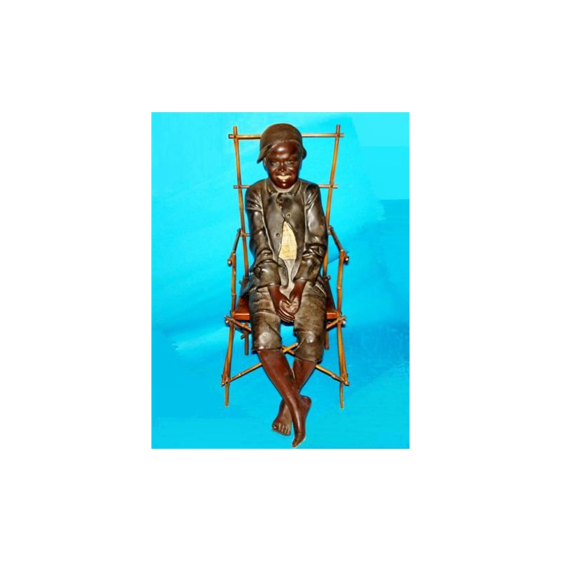 Goldsheider (attributed) young black boy on a bamboo chair figure. Signed (c.1930)