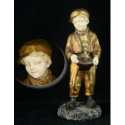 J. DAste A Future Admiral Boy with Toy Boat Bronze and Ivory Figure. Signed to granite base (c.1920)