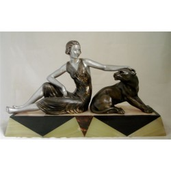 Art Deco Reclining Woman Figure and a Sitting Panther. Spelter on tapering onyx and marble base. Signed 'Plagnet' (c.1925)