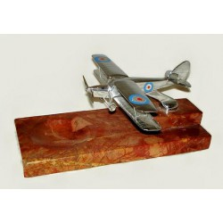 Chromed bronze model of a biplane mounted on a stepped marble base with pin tray (c.1920)