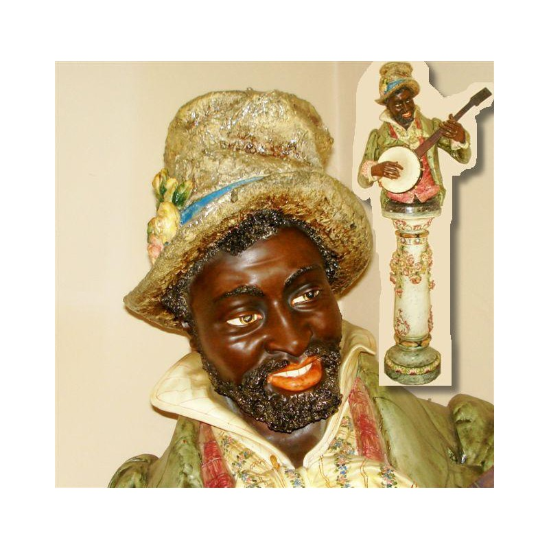 Majolica bust The Minstrel Banjo Player with original floral stand (c.1890)