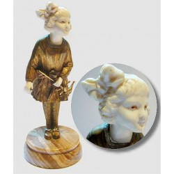 J. DAste Bronze & Ivory Young Girl with Mr Punch. Signed to Onyx base (c.1920)